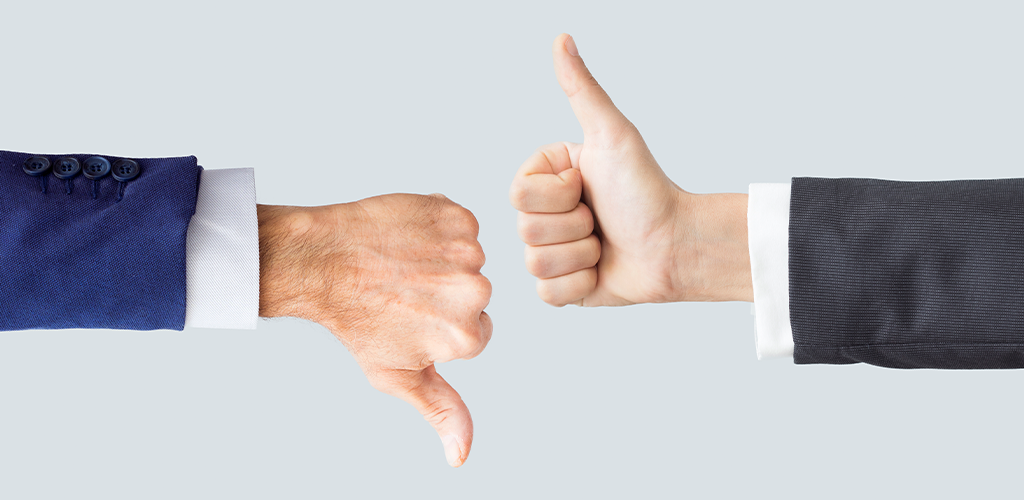Business executives with a thumbs up and thumbs down