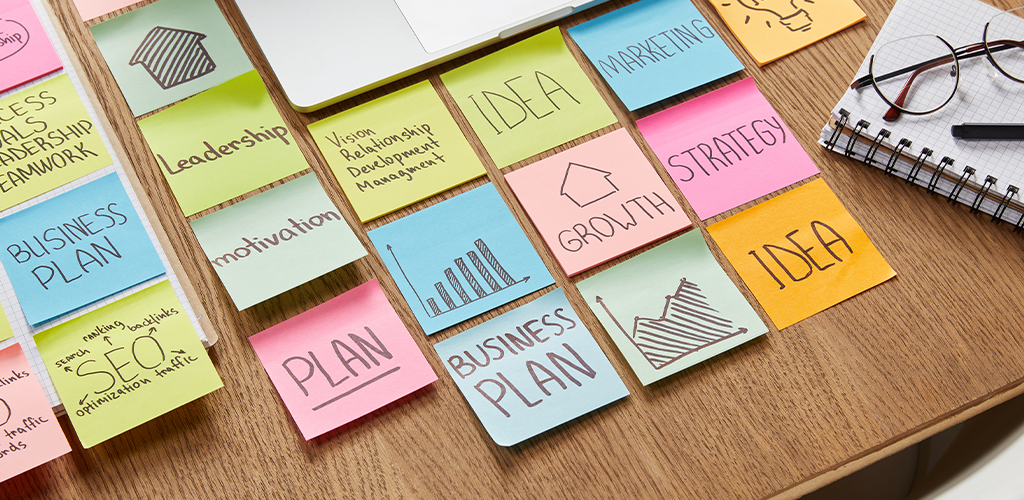 Sticky notes with ideas for a business plan