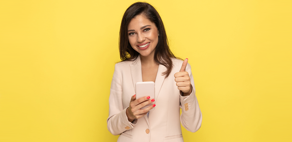 Business woman with phone and thumbs up benefits