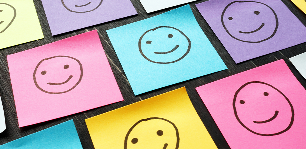Smiley faces on sticky notes for happy customers