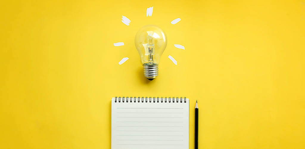 Brainstorming ideas with a lightbulb and notepad