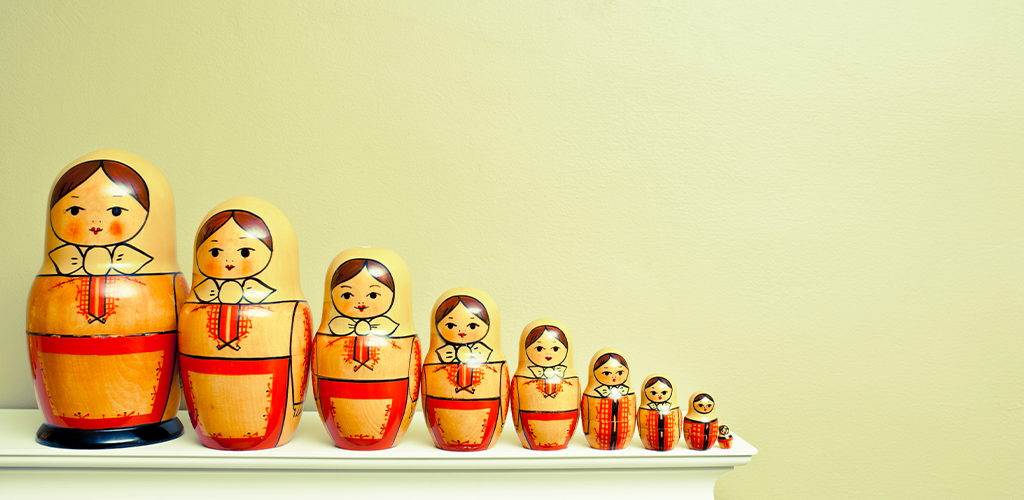 Nesting dolls getting smaller and smaller to represent compression of images